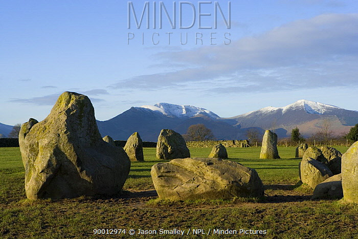 Castlerigg stone circle in the Lake District, Cumbria, UK, winter with snow on the hills in background  -  Jason Smalley/ npl