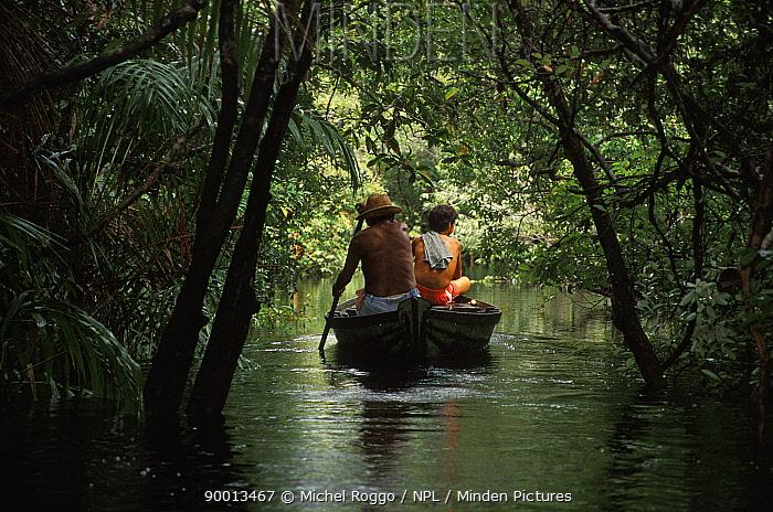 Locals fishing from small boat in flooded Amazon rainforest during rainy season Rio Tabajos, Brazil 1994  -  Michel Roggo/ npl