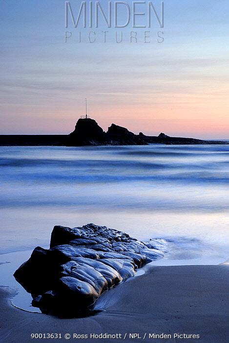 Bude breakwater, from Summerleaze beach, at dusk, Cornwall UK  -  Ross Hoddinott/ npl