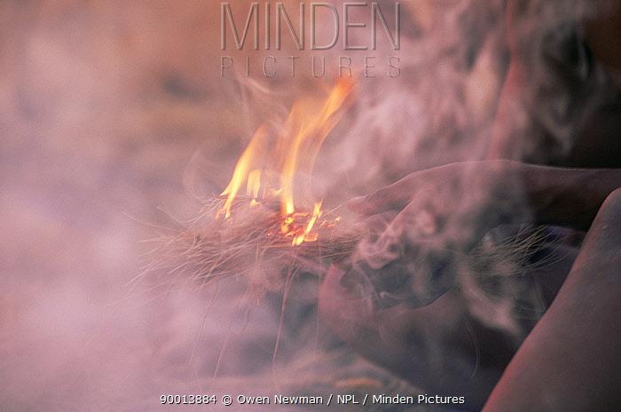Hu, Joan bushman making fire in traditional manner, Namibia 1996  -  Owen Newman/ npl