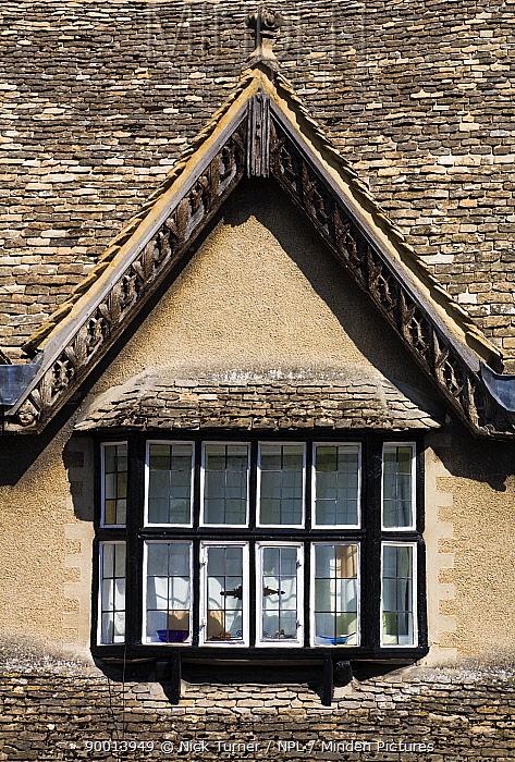 Gabled Cotswold roof on Burford high street, Burford, Oxfordshire, UK  -  Nick Turner/ npl