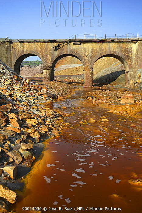 Bridge over the Riotinto river, mineral rich soil mined for iron which seeps into and discolours the river water, Huelva, Spain  -  Jose B. Ruiz/ npl