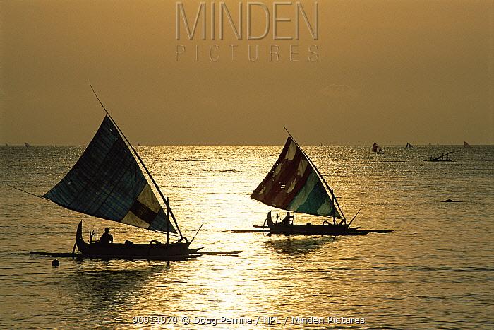 Fishing boats return to shore at dawn after night fishing, Tulamben Bay, Bali, Indonesia, model release  -  Doug Perrine/ npl