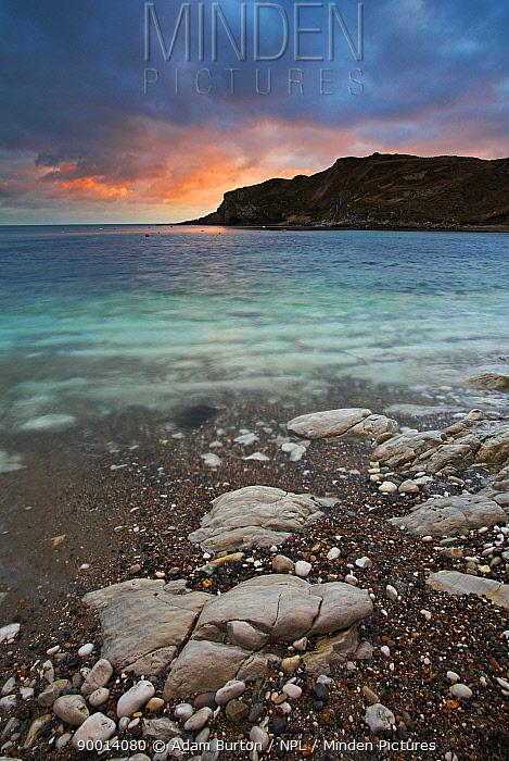 Sunset over the circular bay at Lulworth Cove in Dorset, England Jurassic Coast World Heritage Site  -  Adam Burton/ npl