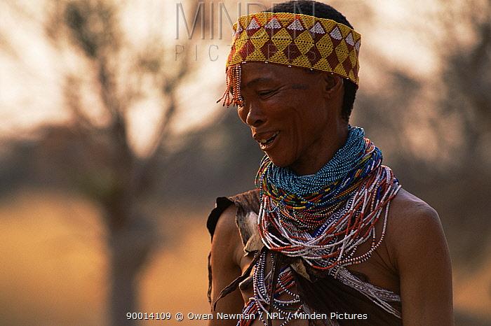 Jo, Hoan bushman with traditional beaded headdress and jewellry, Bushmanland, Namibia 1996  -  Owen Newman/ npl