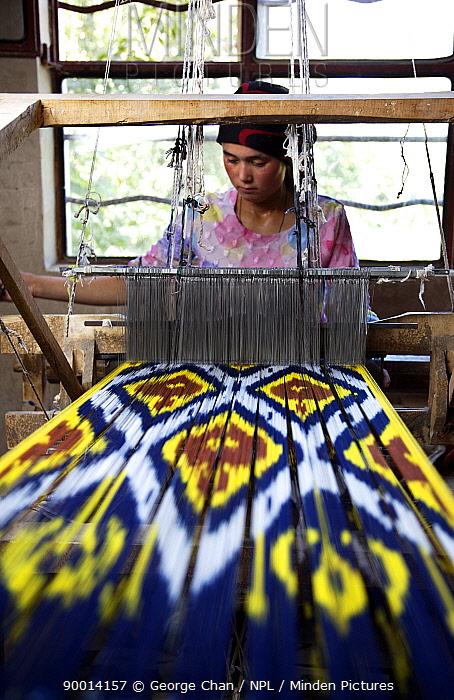 Woman silk weaving on a wooden loom at Hotan (Hetian), a town along the ancient Silk Road Xinjiang Province, North-west China July 2006, BBC Wild China series  -  George Chan/ npl