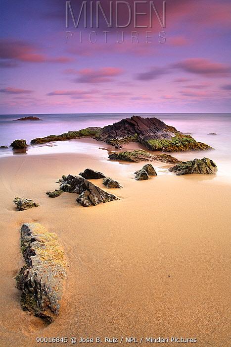 Rocks in the sand, Playa (beach) de los Negretes, Calblanque, La Manga, Murcia, Spain  -  Jose B. Ruiz/ npl