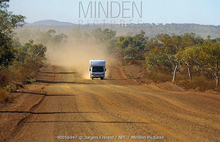 Dust cloud following a Camper van driving along unpaved road in Karijini National Park, Western Australia  -  Jurgen Freund/ npl