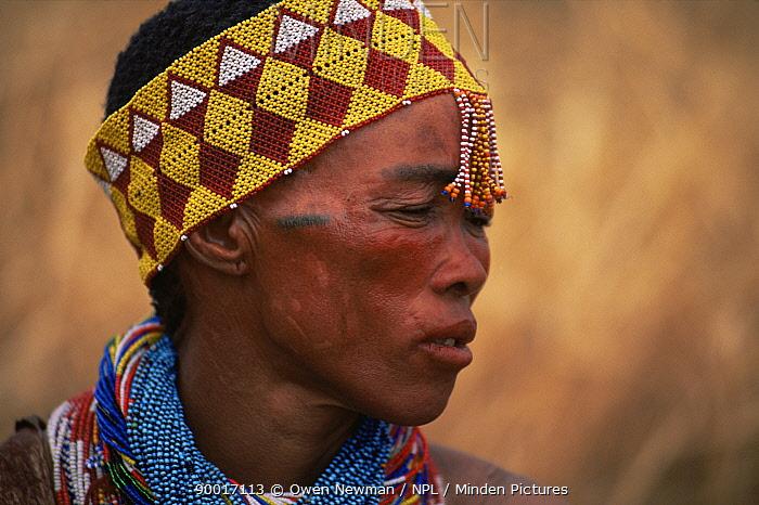 Jo, Hoan bushman with traditional beaded headdress, Bushmanland, Namibia 1996  -  Owen Newman/ npl