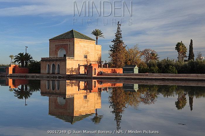 Traditional building reflected at lake at the Menara Gardens in Marrakech, Morocco December 2007  -  Juan Manuel Borrero/ npl