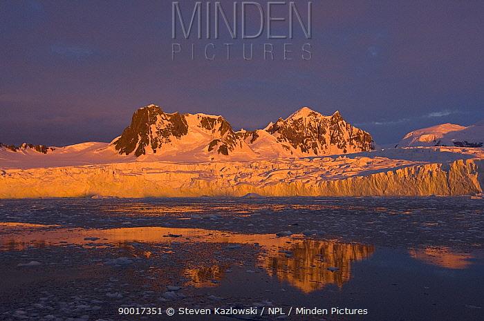 Sunset over the frozen landscape of the western Antarctic peninsula  -  Steven Kazlowski/ npl