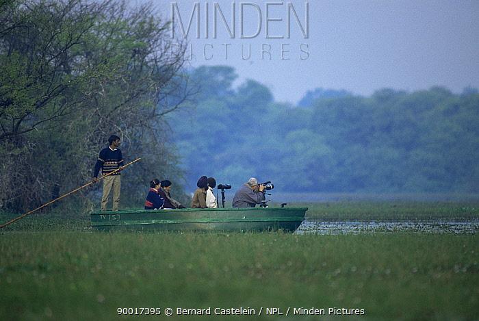 Photographers in boat, Keoladeo Ghana, Bharatpur NP, Rajasthan, India  -  Bernard Castelein/ npl
