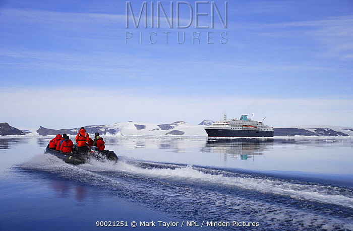 Tourists in zodiac boat with cruise ship in the background Antarctica  -  Mark Taylor/ npl