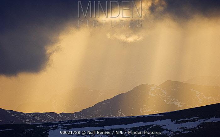 Sun shining though clouds, Grampian mountains, February, Glenshee, Scotland, UK  -  Niall Benvie/ npl