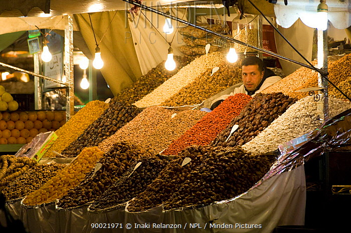 Tradesman selling dates, apricots and various nuts and pulses in the Jemaa el Fna square, Marrakech, Morocco, North Africa  -  Inaki Relanzon/ npl