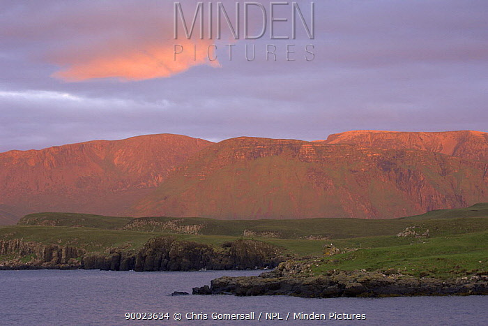Isle of Rum at sunset as seen from Isle of Canna Inner Hebrides, Scotland June  -  Chris Gomersall/ npl