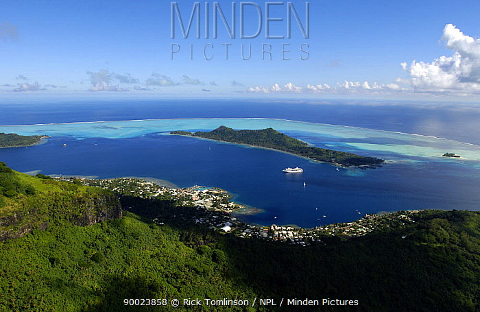 Looking down at an island surrounded by reef in French Polynesia  -  Rick Tomlinson/ npl