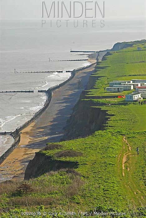 View along north Norfolk coastal cliffs, with sea defences, UK  -  Gary K. Smith/ npl
