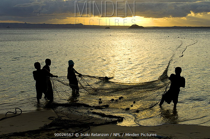 Fishermen pulling in the nets at dawn, Ramena beach, Diego Suarez (Antsiranana), North Madagascar  -  Inaki Relanzon/ npl