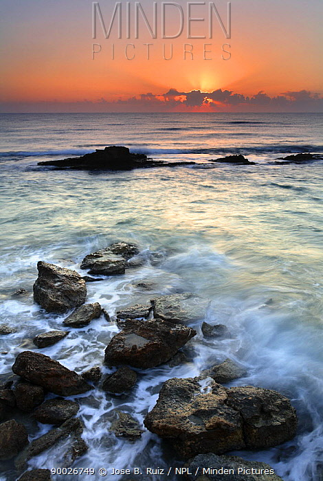 Sunset over rocky shore, Spain  -  Jose B. Ruiz/ npl