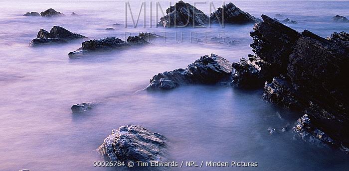 Sunset at Papa Sound, Orkney Movement of surf over the rocks Papa Westray Scotland  -  Tim Edwards/ npl