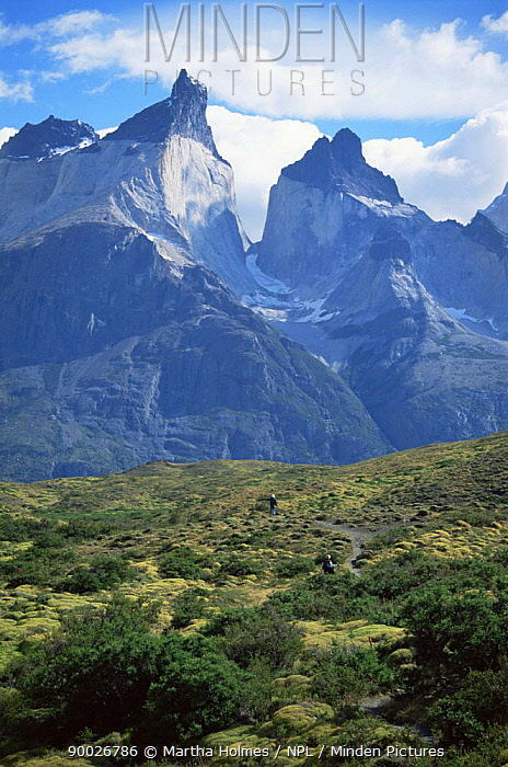 Cuernos del Paine (2669m) with walkers, Torres del Paine NP, autumn, Chile  -  Martha Holmes/ npl