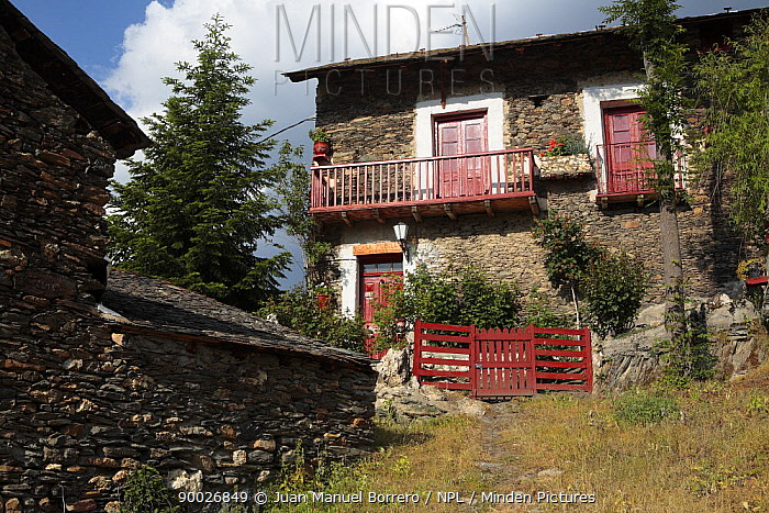 House with red doors and balconies Alendo in the Pyrenees mountains, Catalonia, Lerida, Spain  -  Juan Manuel Borrero/ npl