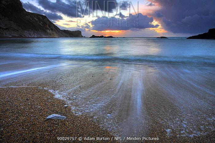 Sunrise in Man O War Cove, Jurassic Coast, Dorset, England  -  Adam Burton/ npl