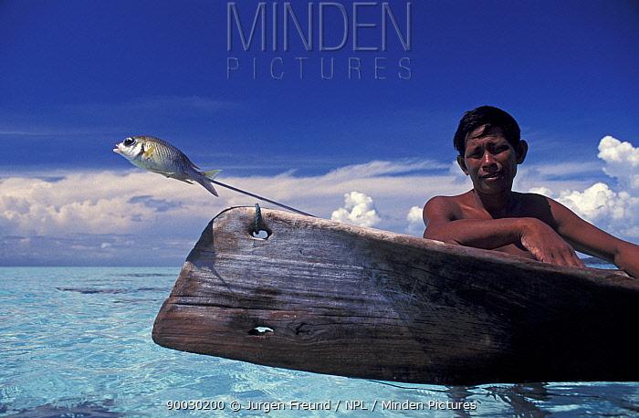 Bajau man with speared fish, Sabah, Borneo, Malaysia  -  Jurgen Freund/ npl