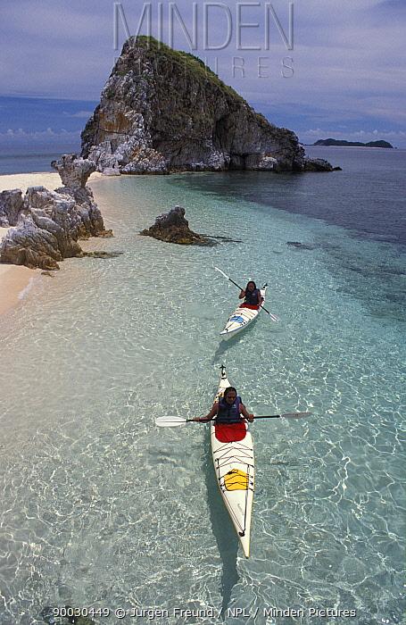 Kayakers explore a tropical island, Philippines  -  Jurgen Freund/ npl