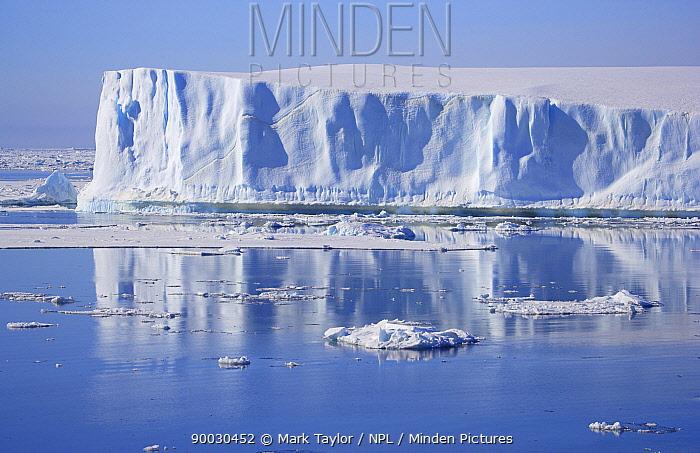 Iceberg in landscape, Antarctica  -  Mark Taylor/ npl