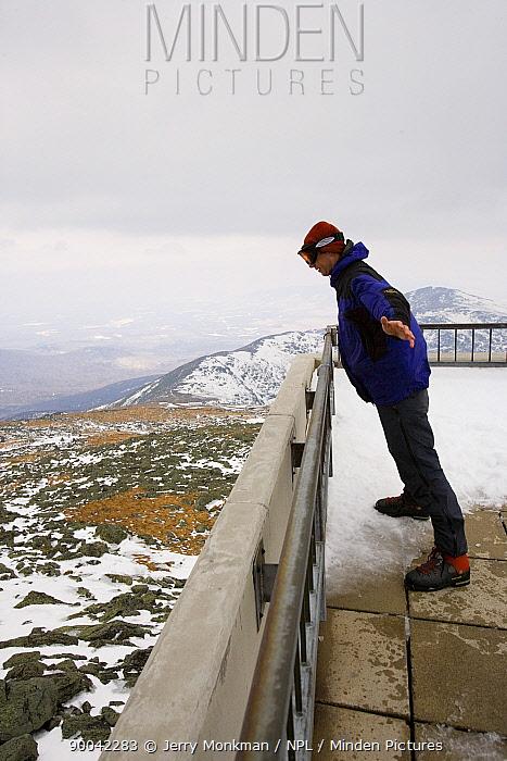 Matt Heid leaning into 50 mph winds at the Observation Deck on Mount Washington, New Hampshire, USA  -  Jerry Monkman/ npl