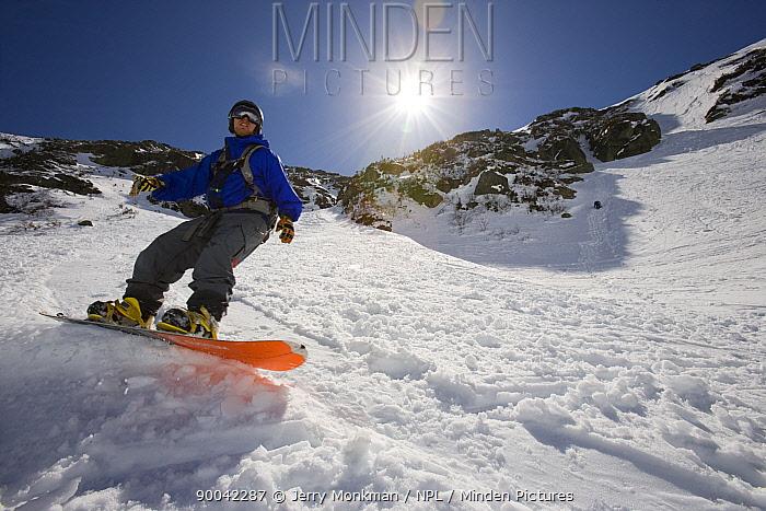 Snowboarding in Tuckerman Ravine, White Mountains, New Hampshire, USA model released  -  Jerry Monkman/ npl