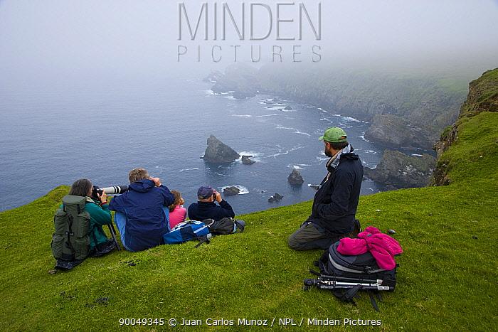 Bird watchers at Hermaness Nature Reserve, Unst Island, Shetland Islands, Scotland, UK  -  Juan Carlos Munoz/ npl