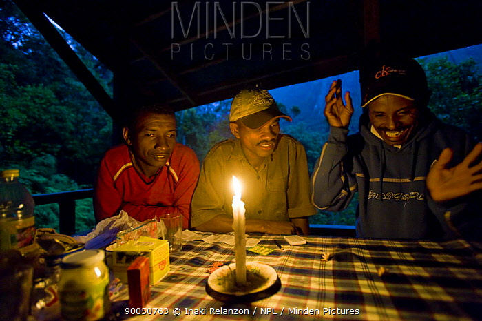 The guides and porters playing a traditional game in Camp 2, Marojejy National Park, after work monitoring endangered Silky sifakas  -  Inaki Relanzon/ npl