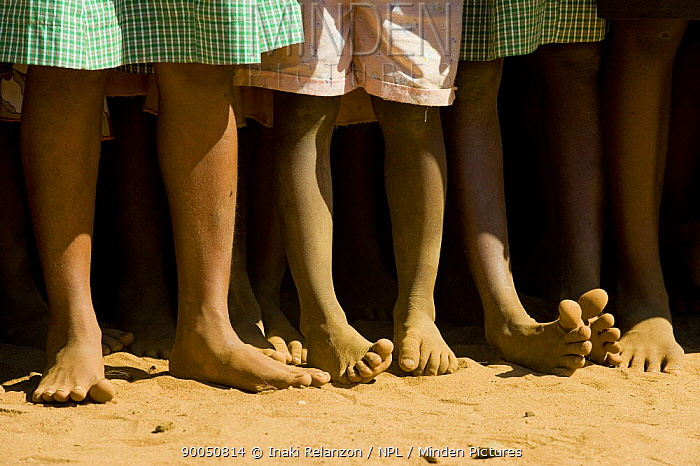 Legs of children at a party to celebrate the 5th of June, World Environment Day, Manerinerina, Majunga, Madagascar  -  Inaki Relanzon/ npl