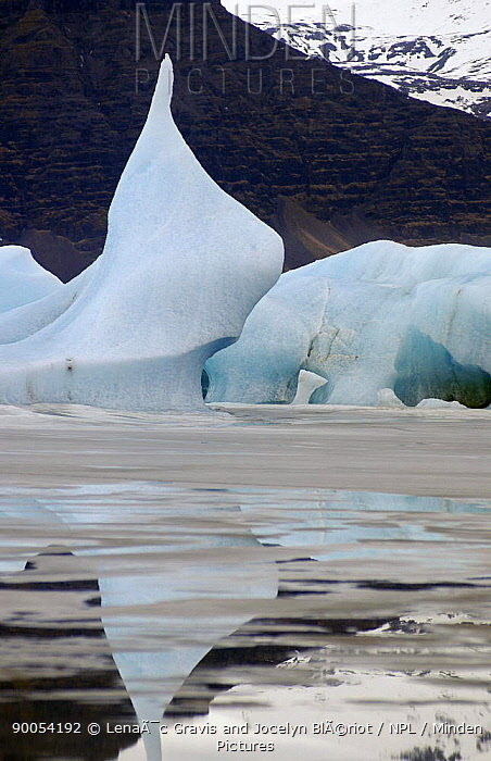 Iceberg reflections on J�kuls�rl?n Ice lagoon at the edge of the Vatnaj�kull glacier, Iceland Ice blocks from the glacier get stuck in the lagoon before drifting out to sea, Iceland February 2005  -  Lenaic Gravis And Jocelyn Blerio