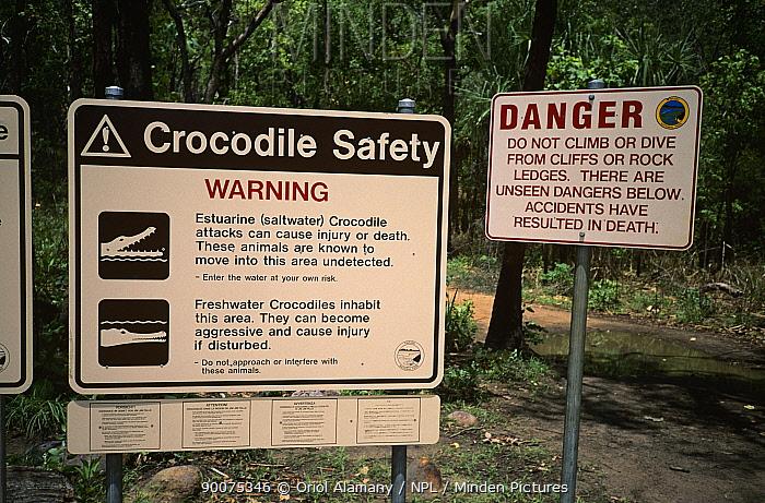 Crocodile warning signs at Jim Jim Falls, Kakadu National Park, Northern Territory, Australia, November  -  Oriol Alamany/ npl