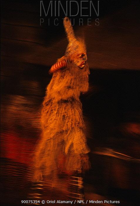 Makishi dancer with mask and stilts in Victoria Falls village, Zimbabwe, September  -  Oriol Alamany/ npl