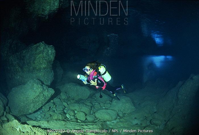 Diver exploring pure alabaster mineral, Alabaster Cave (La Grotta dell'Alabastro), Marina di Camerota, Campania, Italy  -  Angelo Giampiccolo/ npl