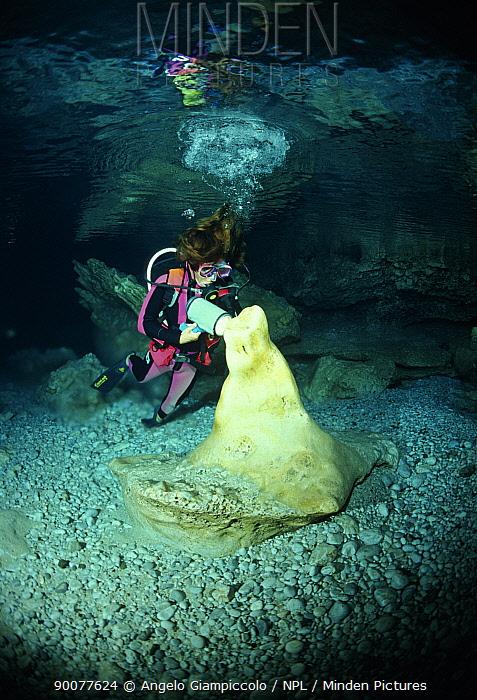 Scuba diver examining pure alabaster mineral, Alabaster Cave (La Grotta dell'Alabastro), Marina di Camerota, Campania, Italy  -  Angelo Giampiccolo/ npl