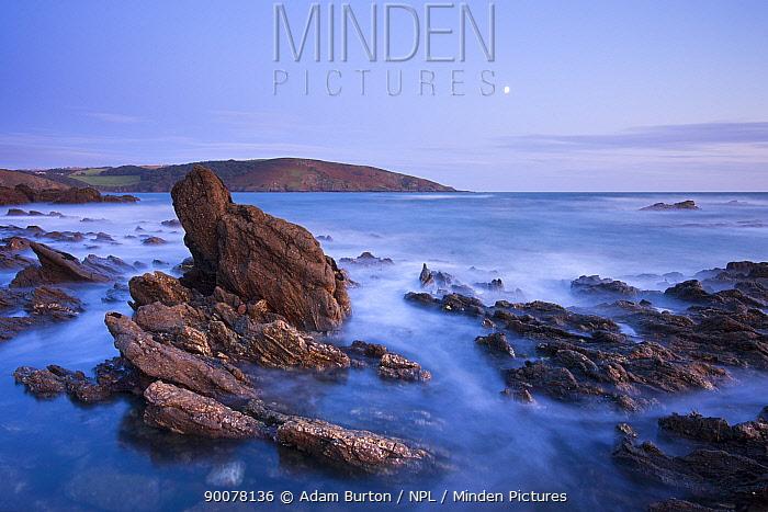 Moon rising above the rocky shores of Wembury Bay at twilight, Devon, England, October 2008  -  Adam Burton/ npl