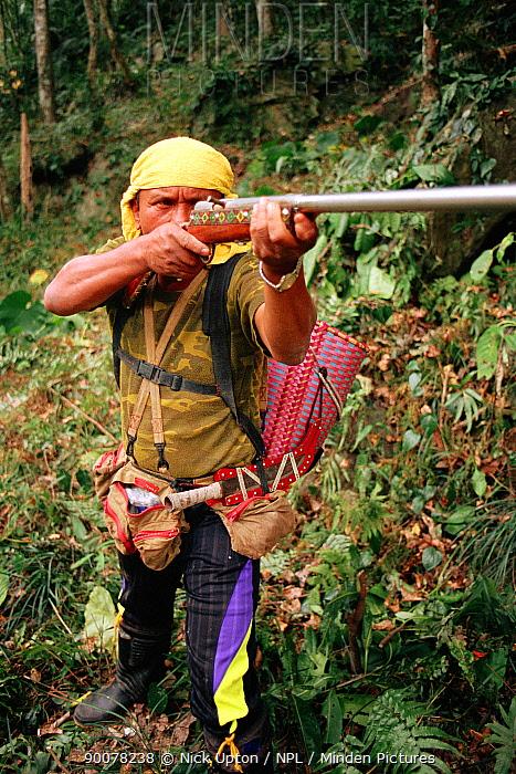 Taiwanese aboriginal hunter of Beinan tribe hunting Formosan macaques (Macaca cyclopis) with home-made gun  -  Nick Upton/ npl