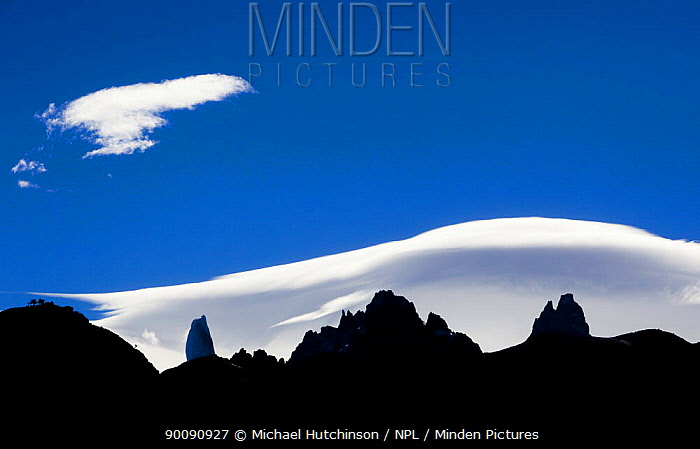 Mountain peaks silhouetted against white clouds, Los Glaciares National Park, Argentina  -  Michael Hutchinson/ npl