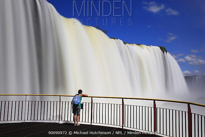 Man on viewing platform watching the Iguazu waterfall, Igua?u National Park, Brazil  -  Michael Hutchinson/ npl