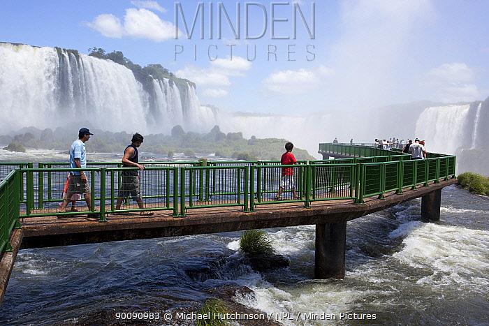 Tourists on walkway by Iguazu waterfalls, Iguacu National Park, Brazil  -  Michael Hutchinson/ npl