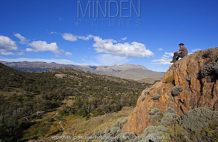 Man contemplating scenery, Los Glaciares National Park, Argentina February 2009  -  Michael Hutchinson/ npl