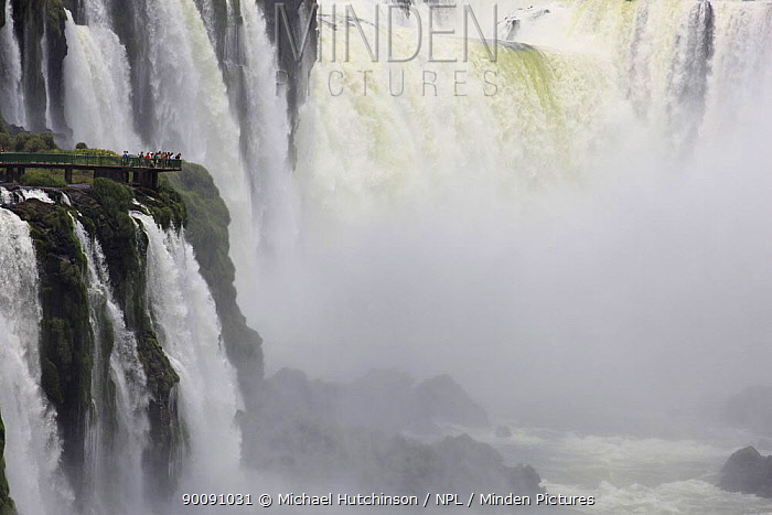 Tourists on viewing platform dwarfed by Iguazu falls including Garganta del Diablo (Devil's throat), Iguacu National Park, Argentina February 2009  -  Michael Hutchinson/ npl