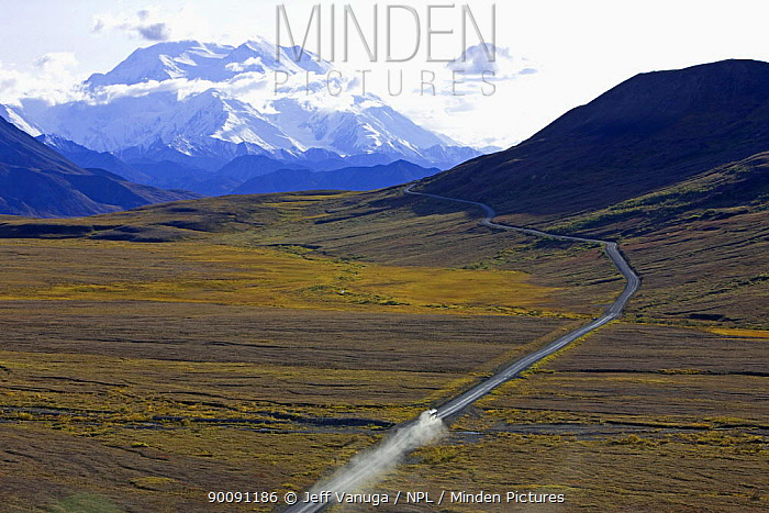 Aerial view of vehicle travelling along road across Denali National Park, with Mount McKinley in the background, Alaska, USA, autumn, September 2008  -  Jeff Vanuga/ npl