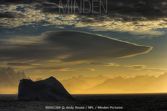 Silhouette of iceberg with lenticular clouds in morning mist, South Georgia (non-ex)  -  Andy Rouse/ npl